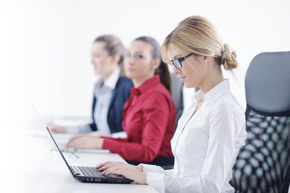Female staff working on laptops
